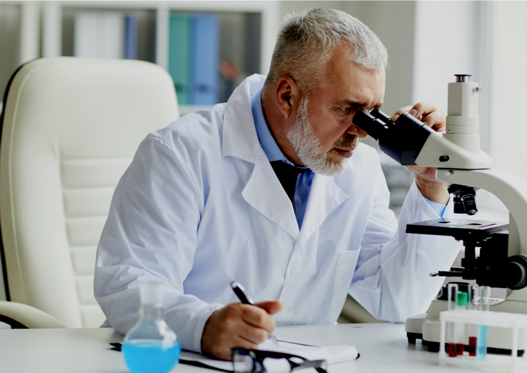 chemist working in a laboratory with a microscope